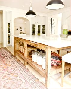 Farmhouse kitchen with Persian rug, open island, country kitchen