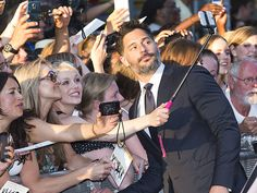 Star Tracks: Thursday, July 2, 2015 | FAN FAVORITE | Joe Manganiello stops for a selfie with some lucky fans while walking the red carpet on Wednesday at the Magic Mike XXL premiere in Amsterdam.