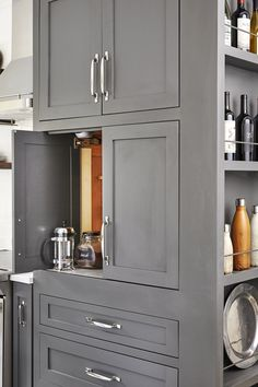 A cabinet to the right of the range serves as a coffee station, while narrow shelves provide handsome display for frequently used items.