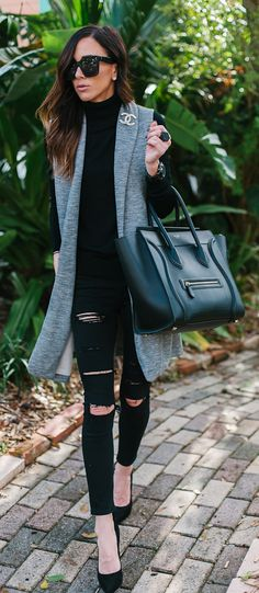 Grey vest and all black