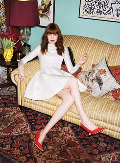My Best Dress - The singer, on her reupholstered sofa and antique tribal Turkish Bergama rug, wearing a Louis Vuitton dress and Dior Haute Couture pumps.Sittings Editor: Victoria Young