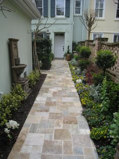 Real Stone Walkway with Pierced Brick Walls Home Entrance in Windmill Harbour, HHI