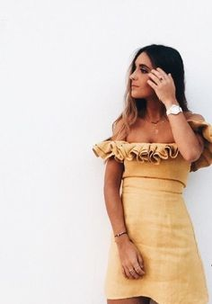 Pretty gold off the shoulder dress.
