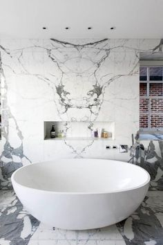 bold veined marble, oval tub