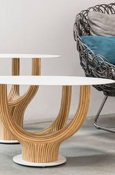 Kenneth Cobonpue Acacia table collection is made of rattan wood with a glass top #homefurhish #office