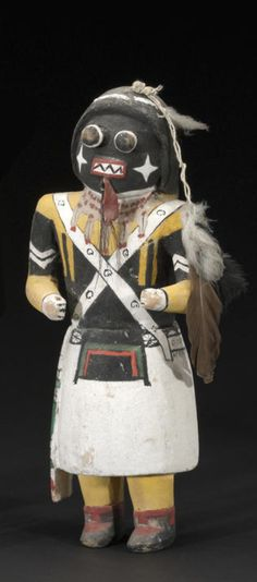 A Hopi kachina doll  Representing Tsa'kwynakatsina, a Zuni warrior kachina, with pop eyes, stars on his mask, and lolling tongue.  height 12 3/4in
