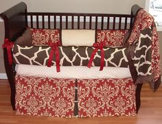 Sweet Cherry Giraffe Baby Bedding    Included in this set is the bumper, blanket, and crib skirt.  There is lots of detail in this custom set including soft cream and chocolate minky, cherry grosgrain ties, cherry and tan damask cotton, and giraffe cotton print too.