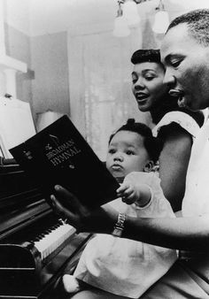 Dr. Martin Luther King Jr. and wife Coretta Scott King sing hymns at the piano, with first-born daughter Yolanda looking on, in a family moment. /Moneta Sleet Jr./Ebony Collection