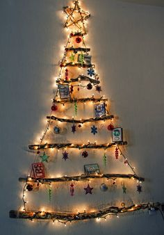 Xmas tree made from recycled sticks. Its a space saver and very creative idea.