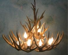 The country chic perfect for an elegant touch to a man cave dream we offer this small bristlecone mule deer antler chandelier and other fine antler lighting and dcor aloadofball Images