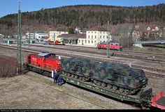 Arriving of an army train in Immendingen. Military people practice unloading and loading of army vehicles on trains.