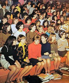 A pinner writes: 1968--school assembly- look at all those skirts.  No jeans.  Clean and combed hair.  This was everyday look.  This is how you dressed for school. Baby boomers time.