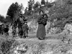 """""""Ragged refugees from Cassino fleeing their blasted town on a road leading to Acquafondata, held by Allied troops."""" Italy. 8 February 1944"""
