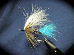 This is a gently hued fly that just fishes and fishes. I think that the effectiveness of these flies is their subtlety. The Whiting Coq De Leon is a feather that I only discovered in the last few years, and I really like it as a substitute for black hackles.  This Spey Iron Steelhead fly offers a pinch of blue, subtle purple body, and mottled flowing hackle topped by a translucent white wing. I like to build this winning combination over either a nickel or bronze Heavy Spey Iron Hook.