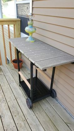 Stuff we made...an old gas grill repurposed as our deck buffet cart...and a solar lamp.