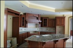 Corner Kitchen with Island......love.....except white cabinets and a black island