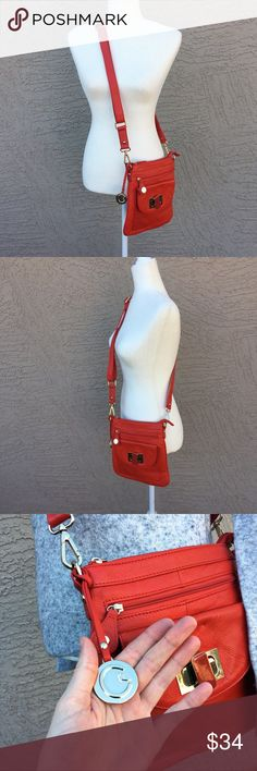 """CYNTHIA ROWLEY Red Crossbody Bag Bright orangey cherry red crossbody bag with adjustable ouch and several pouches. Honestly can't decide if it's genuine or faux leather 🤷🏻♀️. 10.5""""x9.5"""". ✨OFFERS WELCOME✨ (Sweater pictured will also be available soon) Cynthia Rowley Bags Crossbody Bags"""