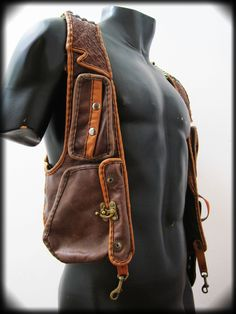 Wanderlust men's leather reversible holster in brown. Playa map on the back. Collar lapels. Detachable leather hood unzips from base. Custom order design by Ahni Radvanyi for Resonating Threads Shop. https://www.etsy.com/shop/ahniradvanyi