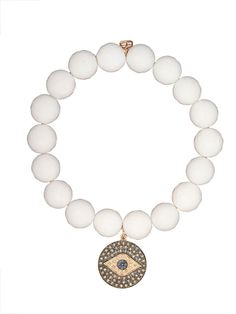 Sydney Evan 14K Rose Gold Evil Eye Charm on White Agate Bracelet. Faceted White Agate 10mm beads with a Rose Gold Evil Eye Charm. The Evil Eye has Champagne and White Diamonds with Blue Sapphires and one Black Diamond in the Center. Available at London Jewelers!