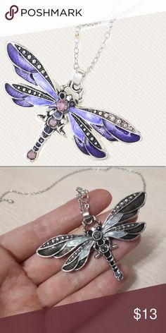 Purple Dragonfly Necklace Beautiful dragonfly necklace. Second picture is just so you can have an idea of the size. This listing is for the purple dragonfly necklace only new in package! Jewelry Necklaces