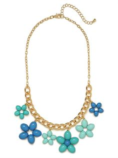 Equal parts playful and chic, this striking necklace flaunts serious flower power. We especially love the contrast of gold chain links versus those floral pendants in fun pops of blue.