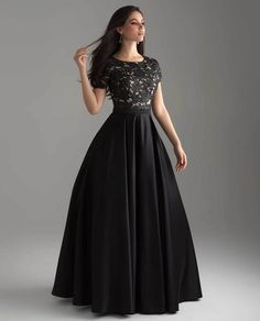 Madison James Lace Top Ballgown style - Charm your guests in this classic black ball gown with a black and white lace bodice with cap sleeves. Pretty Prom Dresses, Prom Dresses With Sleeves, Modest Dresses, Formal Dresses, Black Gown With Sleeves, Halter Dresses, Sleeve Dresses, Wedding Dresses, Designer Evening Dresses