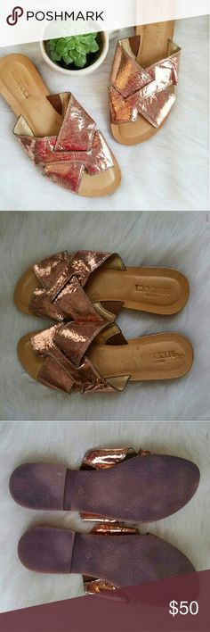 Metallic Foil Cross Strap Slide Sandal 37 Never worn! Some sticker residue on leather insole but no wear otherwise. Very well made sandals! Fun and different. Like slides but Has separate hole for big toe. Rose gold! Size 37. Brand found at Neiman Marcus.  BUNDLE your likes and shoot me and OFFER! Glad to negotiate. Hundreds of items available for discounted bundle offers!  Follow on IG: @the.junk.drawer Sesto Muecci Shoes Sandals