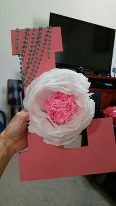 Peach L with tissue paper flower for baby shower