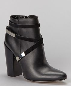 Short and sweet, this irresistible ankle boot is a perfect pair for all seasons. A chic wrapped silhouette and dramatic heel forge a stylish foundation for any wardrobe. 4.5'' heel7'' shaft10.5'' circumferenceInside zipper closureLeather upper and li...