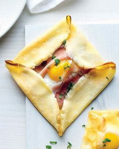 Breakfast never looked so elegant. These crepes are lined with Black Forest ham, with an egg cracked into each.