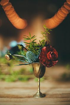 brass goblet centerpieces - photo by Off BEET Productions http://ruffledblog.com/bohemian-nouveau-styled-wedding