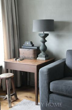 Grey... love the lamp .. grey wood/grey shade  antique stool / charcoal grey sofa