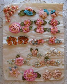 Circa 1920s Twenty Three Never Used Extraordinary Ribbonwork Rosettes Still Sewn On Their Original Tissue Paper New Old Store Stock