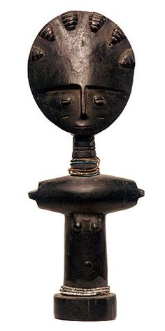 Ashanti, Akuba fertility doll - Probably the most famous of traditional African sculptures, the Akua'ba is a stylized figure carried by girls and women to promote their fertility and to ensure the beauty and health of their offspring. The round, flat disc heads, columnar body with outstretched arms and smooth, black surface convey the Asante (or Ashanti) ideal of beauty.