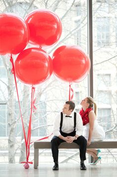 Giant, round, red balloons add a modern sense of whimsy