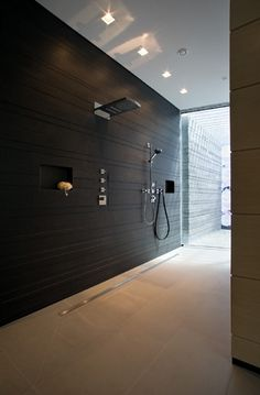 Open shower, Private Spa project by Dreyer _I Love the trench shower drain its about time someone made the change.