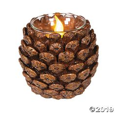 Pinecone Votive Holder Bring the feel of winter and the holidays to your tables. Just add battery-operated candles and enjoy the soft, flickering glow. Buy a few as Christma . Nature Crafts, Fall Crafts, Holiday Crafts, Diy Straw Crafts, Paper Crafts, Summer Crafts, Kid Crafts, Craft Projects, Pine Cone Art
