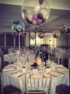 "Small 5"" balloons stuffed inside diamond clear 3ft balloons set as table arrangements"