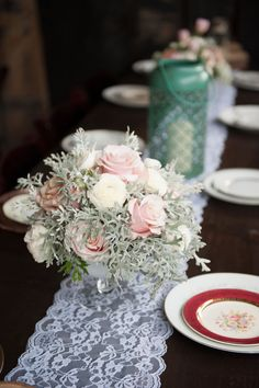 More wedding decor inspiration: lace table runner, hurricane lamps, mismatched fancy china.    Glamorous, Vintage, Rustic Texas Barn Wedding | Venue: Cherokee Rose