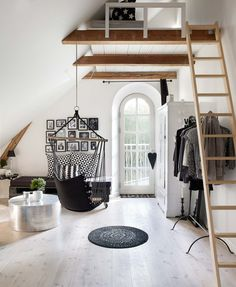 Black and white interior and a hanging chair in an old Danish farm