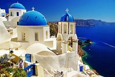 An Oia church with a blue-painted cupola and whitewashed walls. The traditional architecture of Santorini is similar to that of the other Cyclades, with low-lying cubical houses, made of local stone and whitewashed or limewashed with various volcanic ashes used as colours.