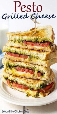 Pesto Grilled Cheese are gourmet grilled cheese sandwiches made with pesto, garden fresh tomatoes and two kinds of cheese! #grilledcheese #pesto