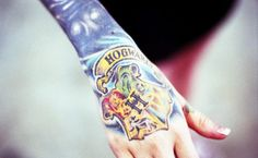 Hogwarts... Not sure how i feel about a hand tattoo but the colors look great (: