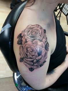 Black and grey realism roses by Jeremiah Klein at Iron Lotus Tattoo in Cedar Rapids Iowa