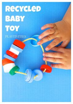 This homemade toy for baby is great because baby can hold it in his arm and make some noise with those bottle caps. He can pull those caps back and forth on the rope.
