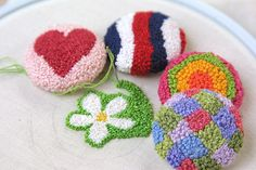 Embroidered buttons (french knots only- wow!) by twiddletails, via Flickr