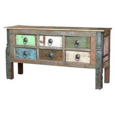 Six-drawer reclaimed wood console with multicolored detailing.  Product: ConsoleConstruction Material: Reclaimed woodColor: MultiFeatures: Drawers have glides and stoppersDimensions: 32.5 H x 64 W x 17.5 DCleaning and Care: Do not use any harsh chemicals to clean