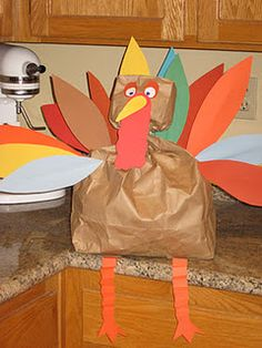 """Paper Bag Turkey filled with mini bags of popcorn so you can """"carve and serve"""" him"""