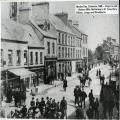 Market Day, Coleraine, 1885- shops on the left: Blacks, Mills, McFarlane's, Dr Forsythe's, Dillons, Longs and Woodburns
