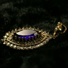 Magical Blue & White Sapphire Pendant Beautiful deep, almost black blue marquis cut sapphire. The surround is pave white sapphire. Antique Patina sterling silver. Just a magical pendant. Perfect for adding to a chain. Does not come with chain used in studio  but if you  need one message  me. Vintage  Jewelry Necklaces